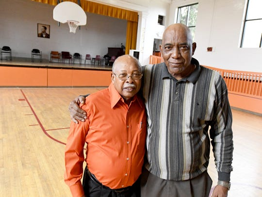 Alphonso Hamilton was once basketball head coach and Jerry Venable a player during the final year of Booker T. Washington High School in 1966.  They stand together in the school's old gym at what is now the Booker T. Washington Community Center in Staunton.
