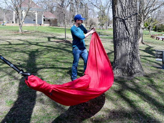 Co-owner Seth Blanchard of Skylark Hammocks sets up