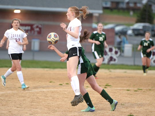 Stuarts Draft's Hannah Chatterton battles a Wilson Memorial player for the ball during Friday's match. The Cougars battled back from a 2-0 deficit to knot the game at 2-2. which is how it ended.