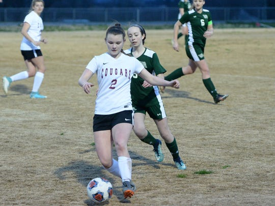 Makenzie Gray works the ball downfield during Friday's match with Wilson Memorial.