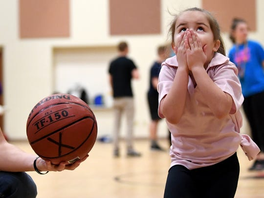 "Daniellah Rodriguez, 7, of Spring Garden Township reacts after watching her foul shot go straight up in the air during the ""Rich Arnold Hoops for Sight"" fundraiser at The Church of the Open Door."