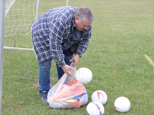 Morris Hickman gets out soccer balls Saturday morning, April 7, at the AYSO soccer fields at Augusta Expo. Hickman is the commissioner of AYSO Region 816.