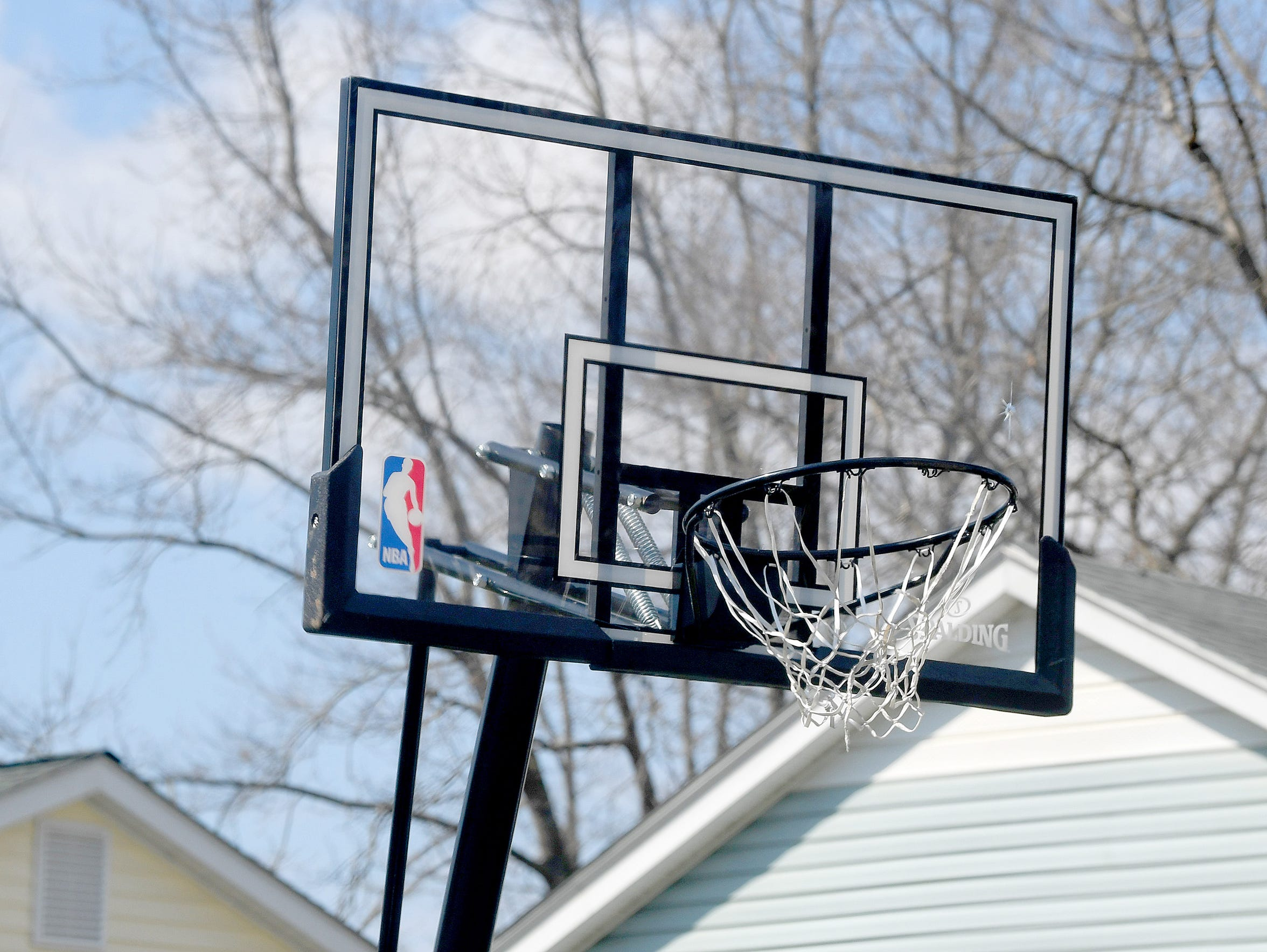 A basketball goal set up in front of one home is one