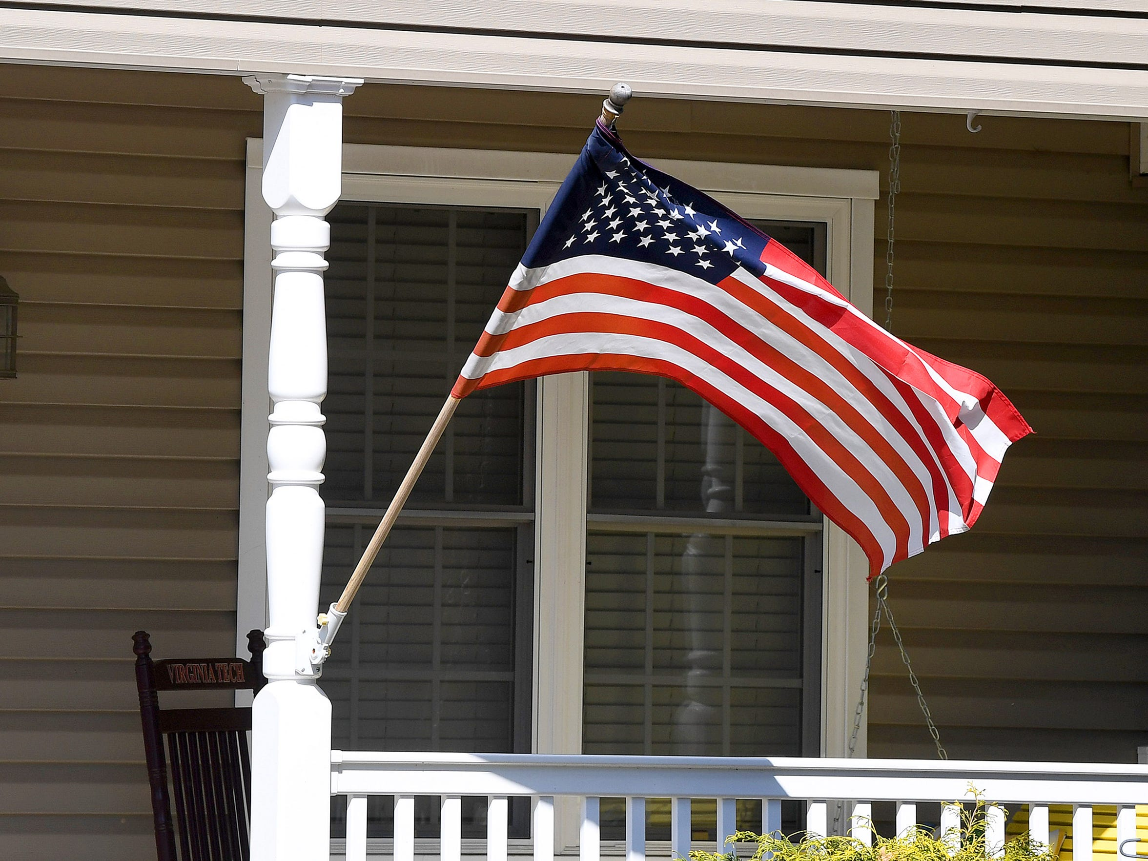 A flag hangs out front of one of the many residences