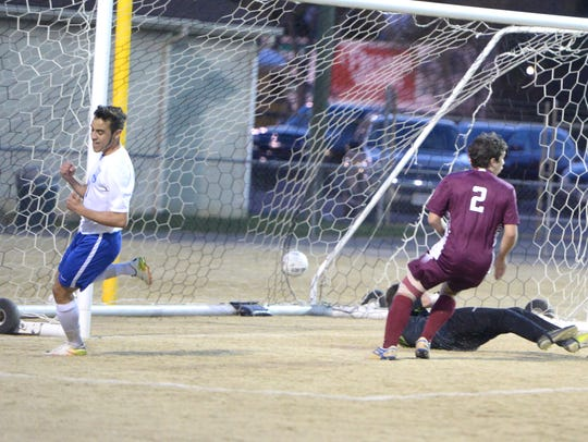 Lee High's Marcos Sasia celebrates after scoring one
