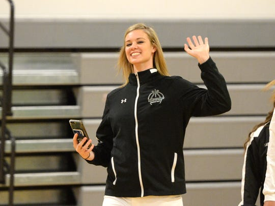 Sam Brunelle waves to the fans as she gets ready to