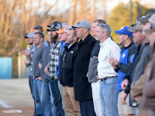 Former Fort Defiance baseball players lined the first