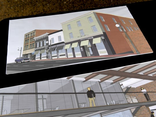 Conceptual drawings on display during the ribbon cutting ceremony for the 32 North Augusta location of Staunton Innovation Hub on Wednesday, April 25, 2018.