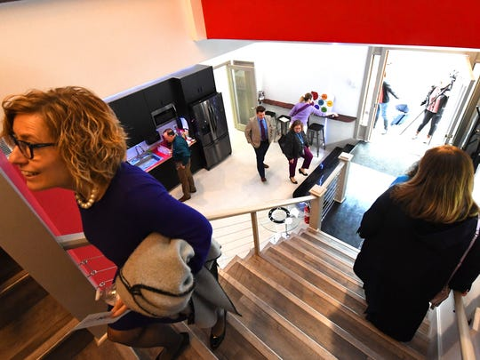 People explore the inside of the 32 North Augusta location of Staunton Innovation Hub following a ribbon cutting ceremony for the location on Wednesday, April 25, 2018.
