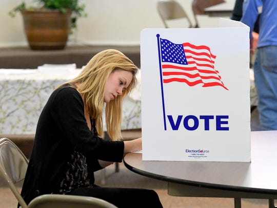 Lauren Reed of Staunton fills out her ballot as she votes at the Ward 5 polling place in Staunton on Tuesday, May 1, 2018.