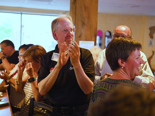 Ron Ramsey, member of the Staunton City School Board, leads a round of applause for other candidates present who one seats on the school board, despite the fact that he was unsuccessful in his own re-election attempt. He attended an election night watch gathering at Redbeard Brewing Company in Staunton on Tuesday, May 1, 2018.