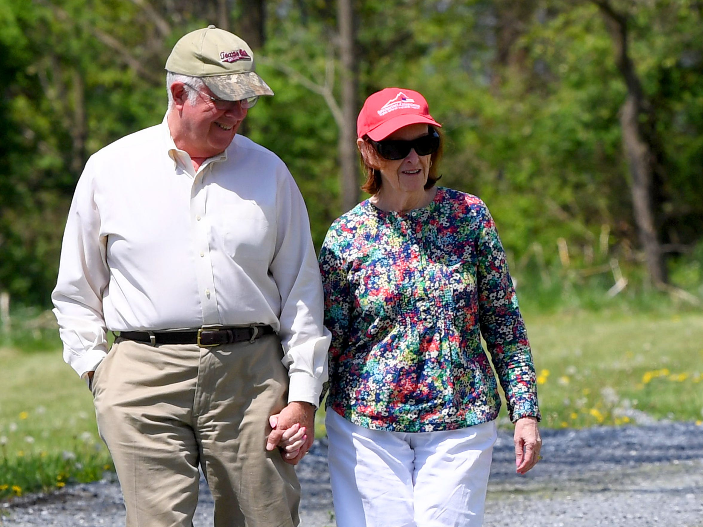 Patrick and Carol Webb hold hands as they walk together on Thursday, May 3, 2018. The husband and wife like to go walking at least 3 times each week. Carol was diagnosed with Alzheimer's disease in November 2016.