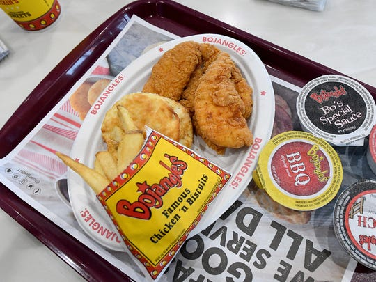 Fries and boneless chicken with a biscuit on a plate at the new Bojangles' on Richmond Road in Staunton on Wednesday, May 16, 2018. The restaurant opens this Saturday.