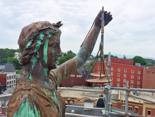 Lady Justice gets new scales