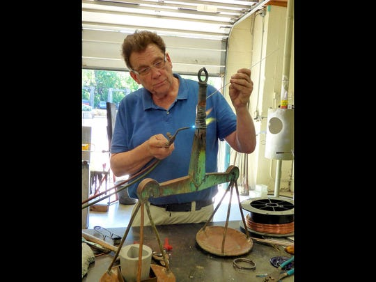 Doug Sheridan of Sunspots Studio works on the scales