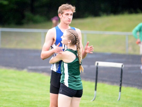 Broadway's Jessica Cantrell hugs Jacob Jones after his third-place finish in the 400, a disappointing finish for the Fort Defiance junior.