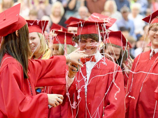 Graduates celebrate at the end of commencement exercises at Riverheads High School on Friday night, May 18, 2018.