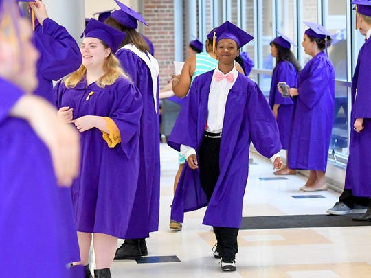 Graduate Charnai Smith walks with head held high and a smile before the start of commencement exercises at Waynesboro High on Saturday morning, May 19, 2018.
