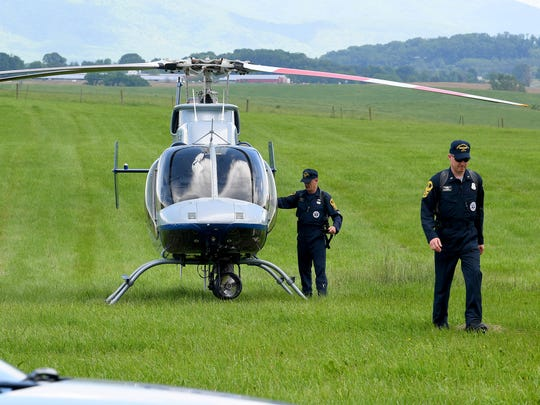 A Virginia State Police helicopter arrives at a farm on Craig Shop Road where they are investigating an emergency landing by an instructor pilot and his student in a single engine Piper Cherokee Arrow airplane on Tuesday, May 22, 2018.