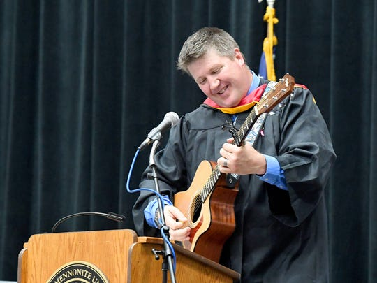 Science teacher Brent Hull finishes his commencement