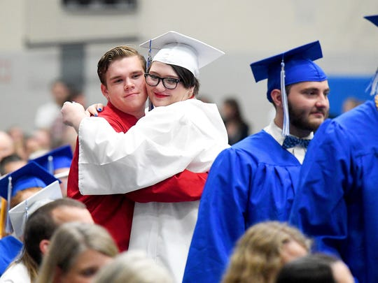 Graduate Cheyenne Kay Moyers stops to hug the person