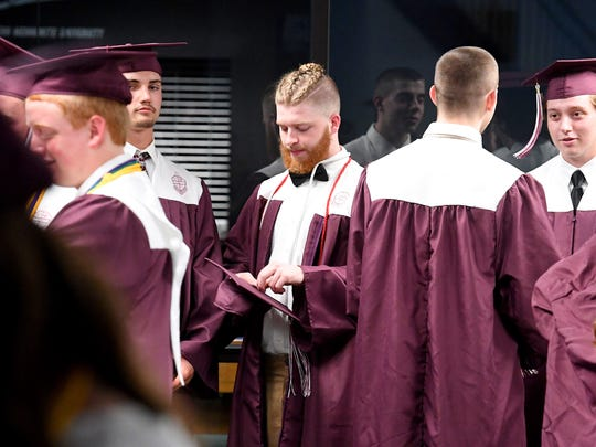 Graduate Dillon Knott waits with classmates before