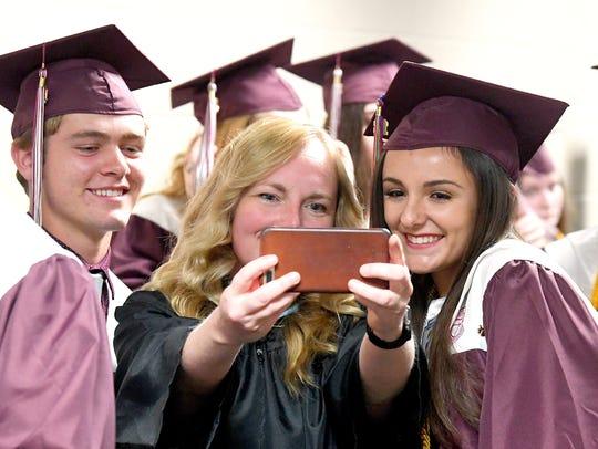Teacher Christie Crittenden (center) takes a selfie