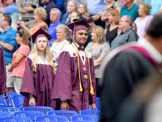Graduates enter during the processional at Stuarts