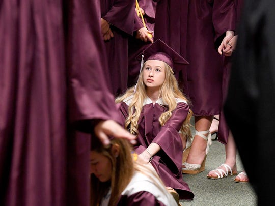 Graduate Brooke Boyd relaxes by sitting on the floor