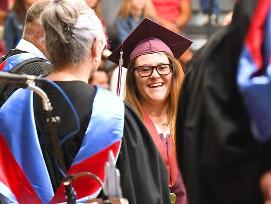 Graduate Loryl Brynn Kennedy smiles as she waits to