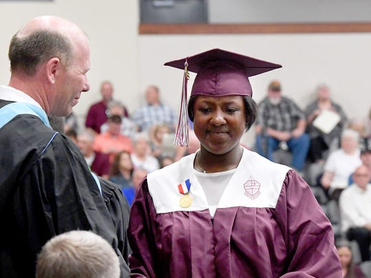 Graduate Eboni Sade Woodson sheds a tear for her mother