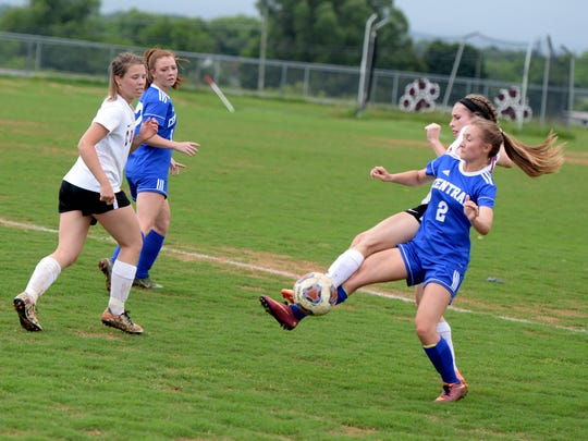 Stuarts Draft's Savannah McCarthey and Central Woodstock's Gracie Foltz both go for the ball during Monday's Region 2B girls soccer quarterfinal match.