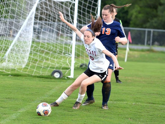 Stuarts Draft's Lyndsay Harris works to keep the ball away from Clarke County's Cameron Sowers Wednesday during the Region 2B girls soccer semifinals. Draft lost 3-2.