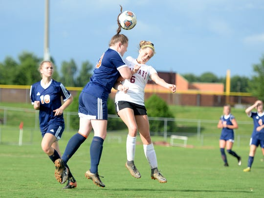 Stuarts Draft's Rissa Martin (6) and Clarke County's Cameron Sowers collide as they both go for the ball during Wednesday's Region 2B girls soccer semifinal. Clarke won 3-2.