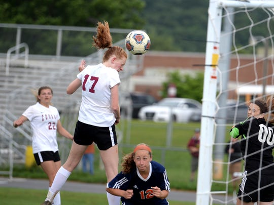 Stuarts Draft's Hannah Chatterton tries to head the ball into the goal Wednesday during her team's Region 2B girls soccer semifinal loss to Clarke County.