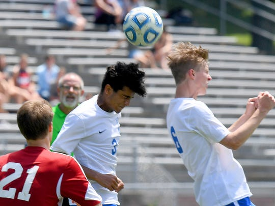 Robert E. Lee's Quinn Anderson and Noah Vanhoy come together to both head the ball. R.E. Lee defeated George Mason, 3-0, to win the Region 2B boys soccer championship during a game played in Staunton on Friday, June 1, 2018.