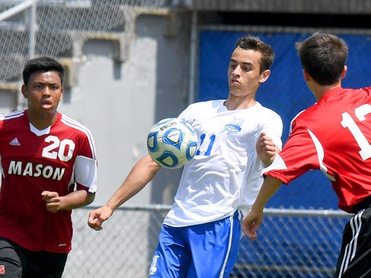Robert E. Lee's Marcos Sasia takes control of the ball. R.E. Lee defeated George Mason, 3-0, to win the Region 2B boys soccer championship during a game played in Staunton on Friday, June 1, 2018.