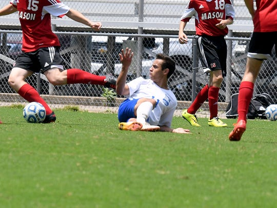 Robert E. Lee's Marcos Sasia looks over to a game official after he goes down. R.E. Lee defeated George Mason, 3-0, to win the Region 2B boys soccer championship during a game played in Staunton on Friday, June 1, 2018.