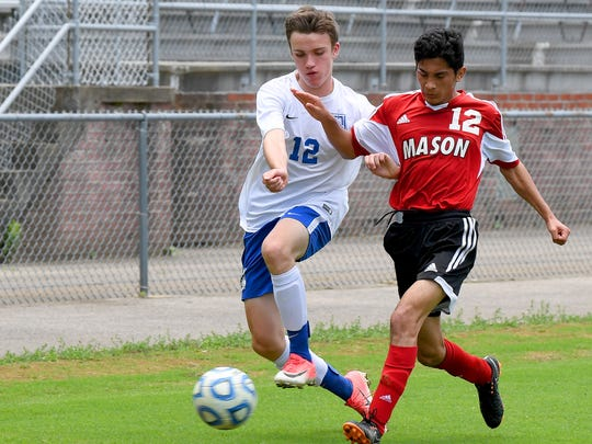 Robert E. Lee's Wilson von Seldenick races George Mason's Bryan Villegas Sanchez as they chase the ball for control over it. R.E. Lee defeated George Mason, 3-0, to win the Region 2B boys soccer championship during a game played in Staunton on Friday, June 1, 2018.