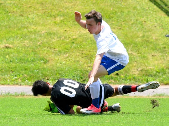 Robert E. Lee's Wilson von Seldenick tries to reach the goal with the ball, but George Mason goalie Zain Hameed slides in to dive onto it. R.E. Lee defeated George Mason, 3-0, to win the Region 2B boys soccer championship during a game played in Staunton on Friday, June 1, 2018.
