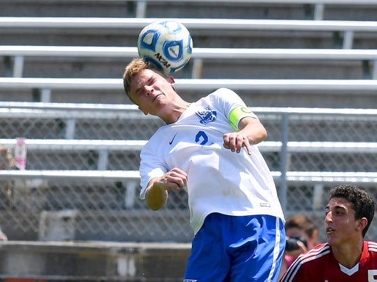 Robert E. Lee's Luke Gaines heads the ball. R.E. Lee defeated George Mason, 3-0, to win the Region 2B boys soccer championship during a game played in Staunton on Friday, June 1, 2018.