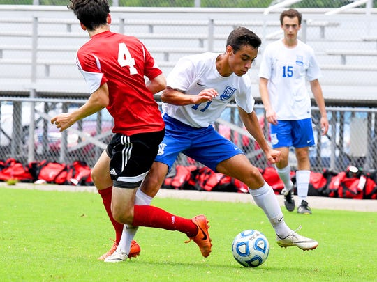 Robert E. Lee's Marcos Sasia controls the ball. R.E. Lee defeated George Mason, 3-0, to win the Region 2B boys soccer championship during a game played in Staunton on Friday, June 1, 2018.