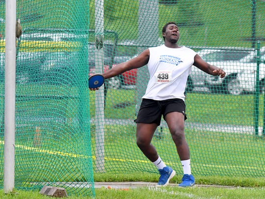 Fort Defiance's Traevon throws the discus while competing