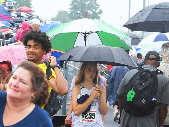 Umbrellas are everywhere as they are used by athletes