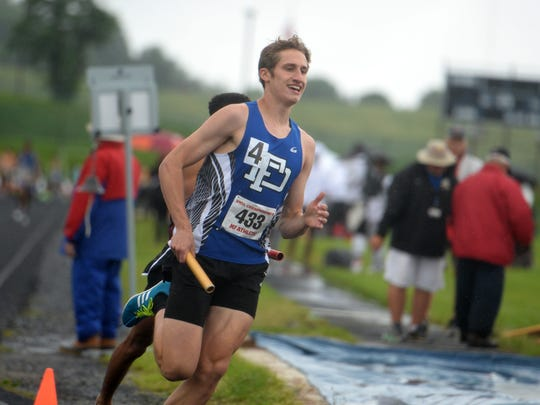Jacob Jones anchors Fort Defiance's 4X800 boys relay team Sunday morning at the state 3A track meet at Harrisonburg High School. Fort finished seventh overall.