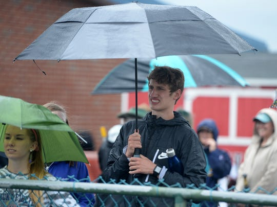 Fort Defiance junior Jacob Jones waits in the rain for his next event Sunday at the state 3A track meet at Harrisonburg High School.
