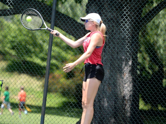 Emma Tomlinson, a Riverheads junior, practices tennis at Gypsy Hill Park Tuesday. Tomlinson will team with Jessica Milo Friday for the Class 1 doubles state semifinals.