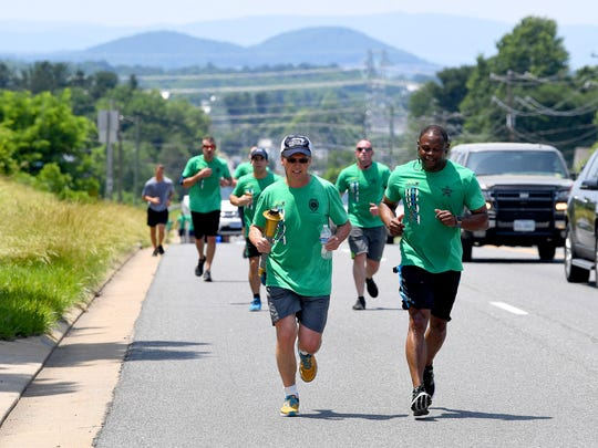 Paul Lightner with Virginia Probation and ParoleÕs District 12 is the current bearer of the Special Olympics torch as it travels along U.S. 250 near Waynesboro as part of the during the Law Enforcement Torch Run for Special Olympics on Thursday, June 7, 2018. They participate in the 1,900-mile, 8-day Torch Run which involves more than 2,000 law enforcement officers and personnel with 300 law enforcement agencies across Virginia.
