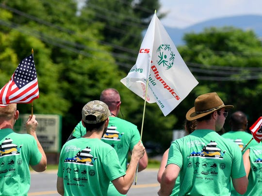Special Olympics athletes join with theAugusta County SheriffÕs Office and other law enforcement agencies running the Special Olympics torch along U.S. 250 near Waynesboro as part of the during the Law Enforcement Torch Run for Special Olympics on Thursday, June 7, 2018. They participate in the 1,900-mile, 8-day Torch Run which involves more than 2,000 law enforcement officers and personnel with 300 law enforcement agencies across Virginia.