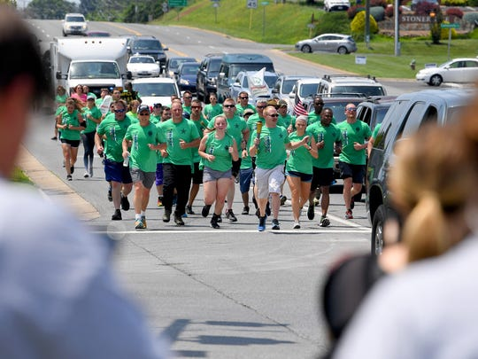 Special Olympic athlete Jacob Robertson of Fort Defiance leads the way with the torch. He joins other athletes, the Augusta County SheriffÕs Office and other law enforcement agencies in running the Special Olympics torch along U.S. 250 near Waynesboro as part of the during the Law Enforcement Torch Run for Special Olympics on Thursday, June 7, 2018. They participate in the 1,900-mile, 8-day Torch Run which involves more than 2,000 law enforcement officers and personnel with 300 law enforcement agencies across Virginia.
